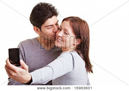Couple Taking Pictures With Cell Phone