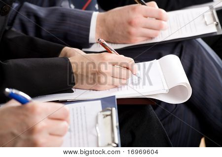 Line of writing hands