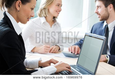 Image of business people working in the office