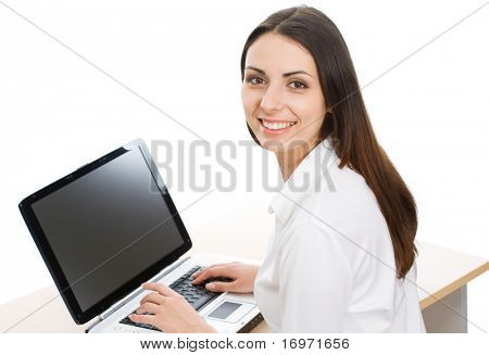 Portrait of beautiful secretary while typing on the laptop