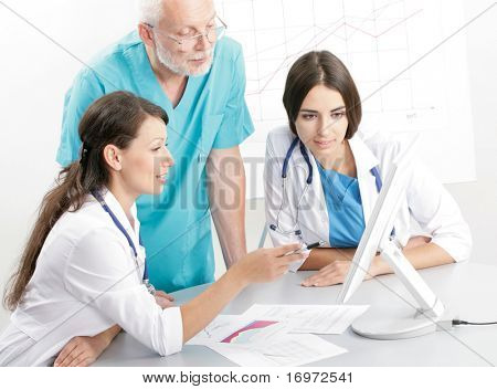 Medical theme: doctors are studying a medical report