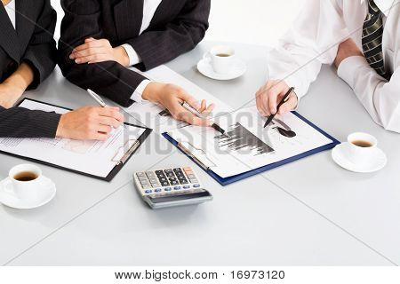 Image of business people hands working with documents at meeting