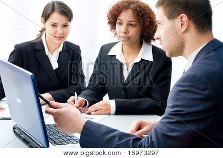 Three businesspeople discussing