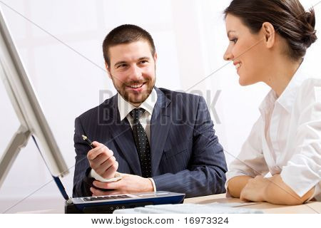 Young and good-looking business people are working in the meeting room