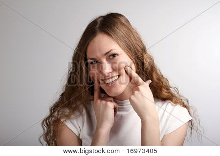 Girl Stretching Her Smile With Fingers