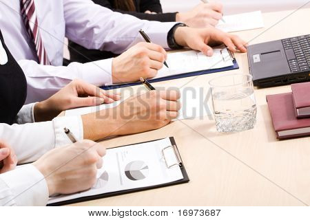 Close-up of business person hand working with document