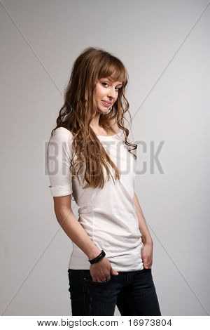 Young Smiling Girl In A White T-shirt