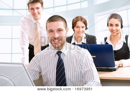 Young successful businessman and its team