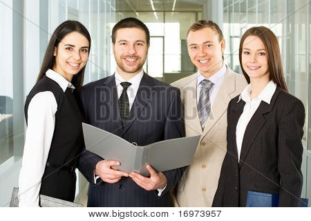 Group of young businesspeople smile and look at the camera