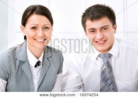 Image of successful partners looking at camera