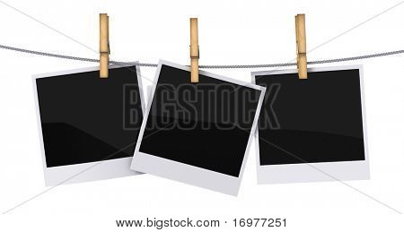 Blank photo frames hanging on a rope