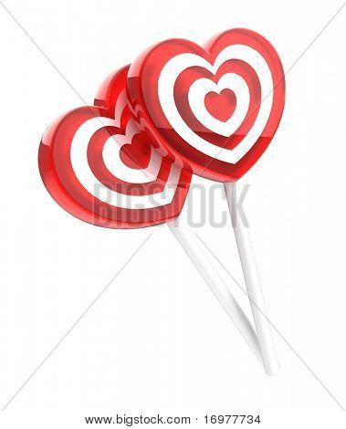 Corazón de dos piruletas en forma aislada en blanco