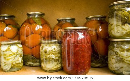 Jars with preserves homemade vegetables and jam.
