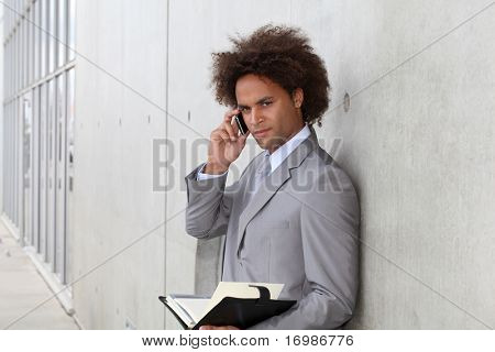 Portrait of a businessman working outside the office