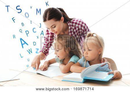 Teacher working with children at kindergarten. Speech therapy concept