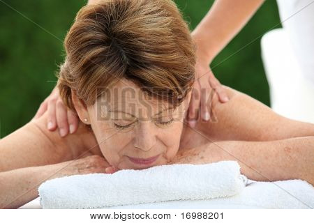 Senior woman on a massage bed