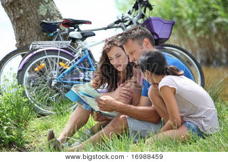 Family on bicycle ride in the countryside