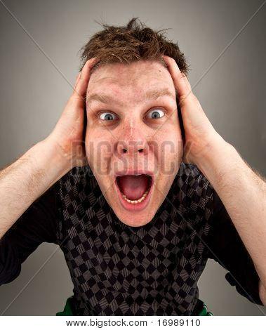 Portrait Of Screaming Surprised Man