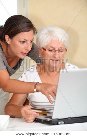 Elderly woman and young woman shopping on internet