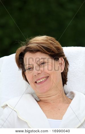 Closeup of senior woman relaxing on massage bed