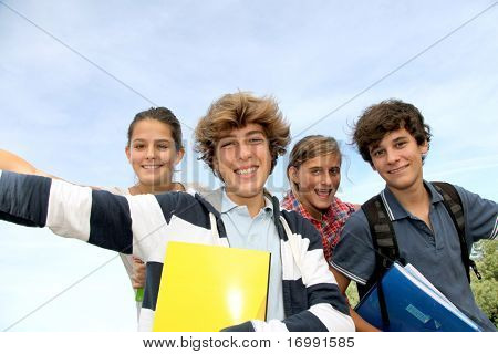 Group of teenagers studying outside the class