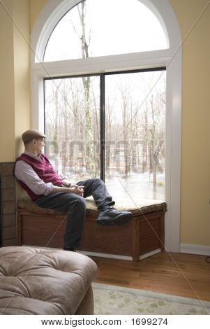 Man In Living Room Looking At Flood Damage