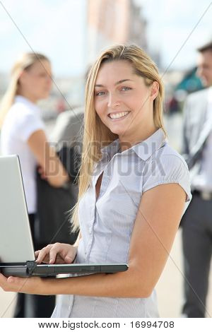 Blond businesswoman with laptop computer