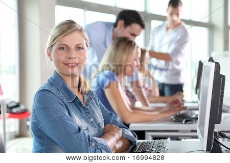 Closeup of blond woman attending training course