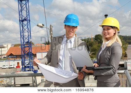 Architect and supervisor checking site under construction