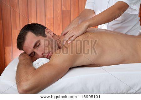 Man having a facial massage in spa center