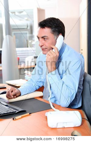 Businessman in the office talking on the phone