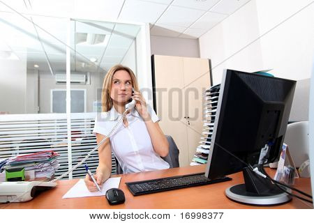 Woman talking on the phone in the office