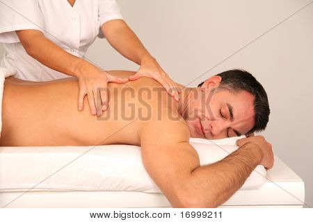 Man laying on massage bed