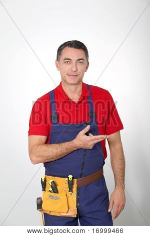 Carpenter standing on white background
