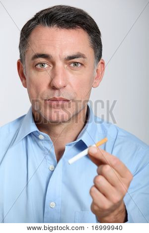 Closeup of man trying to quit smoking