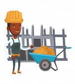 African builder with thumb up standing near wheelbarrow. Young builder in hard hat giving thumb up.  poster