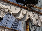foto of yardarm  - Rigging sailsyardarm and mast on old sailing ship - JPG