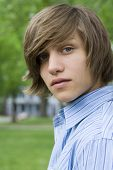stock photo of teenage boys  - Outdoor spring portrait of a teenaged boy and a bench - JPG