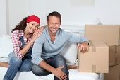 stock photo of married couple  - Couple moving in new house - JPG