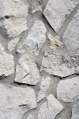 picture of fieldstone-wall  - the detail of a pattern on a exterior wall - JPG