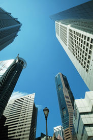 pic of commercial building  - Skyscrapers and high rise buildings against a clear blue sky - JPG