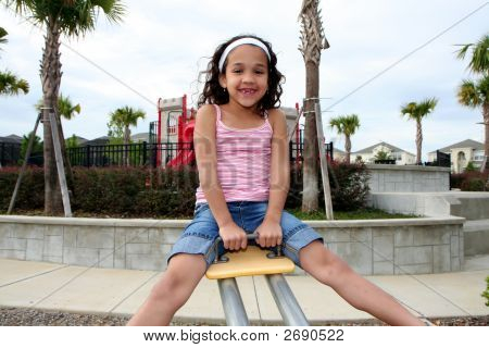 Young Girl On Playground