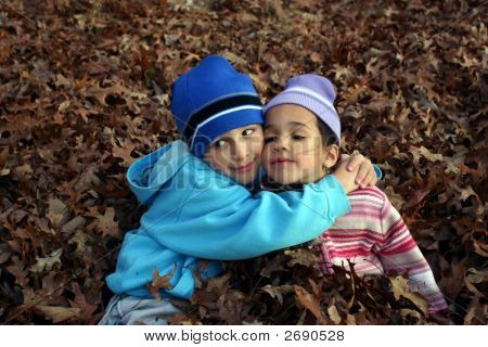 Two Children In Leaves