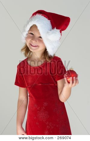 Girl In Red With Christmas Ball