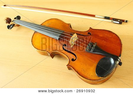 antique violin with a fiddlestick