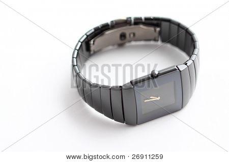 elegant wristwatch on grey