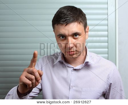 businessman admonishing by finger