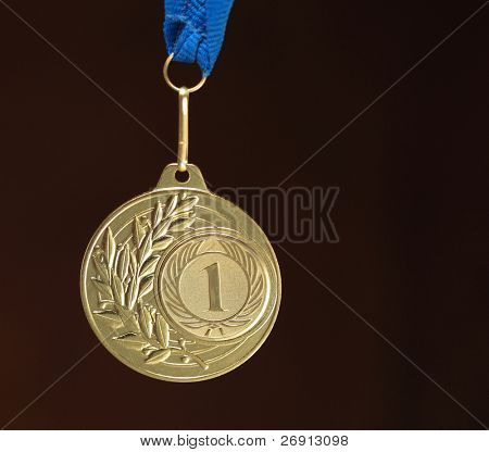 gold medal on dark background