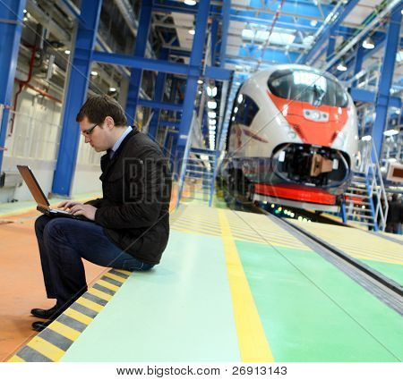 engineer making his work in the service depot