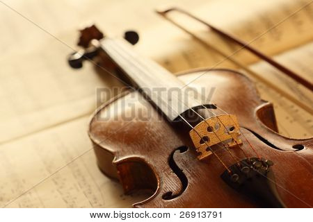 antique violin with fiddlestick